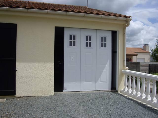 Portes de garages sarl moreau david lu on sarl for Garage boulot les sables d olonne